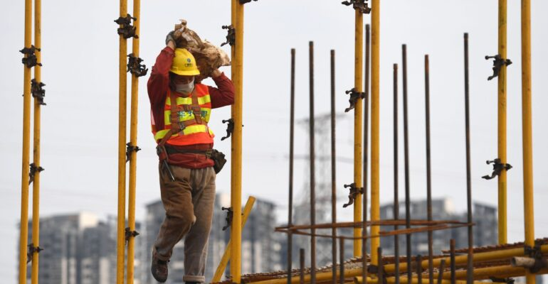 Nanning, China's Guangxi Zhuang Autonomous Region. 21st Feb, 2020. A laborer works at a construction site in Nanning, capital of south China's Guangxi Zhuang Autonomous Region, Feb. 21, 2020. Construction industry has gradually resumed amid strict prevent